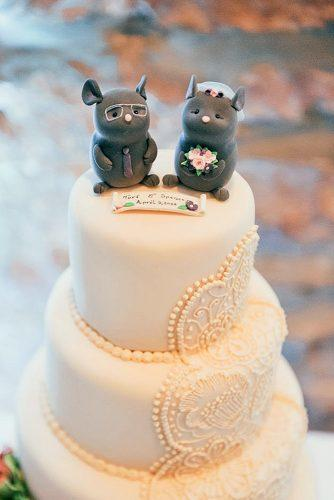 unique wedding cake toppers two mice groom with glasses and bride in veil on top of white cake 1486 photography