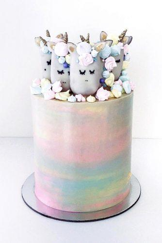 unique wedding cakes rainbow cake with unicorns on top rymondtn via instagram