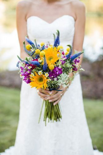 wildflower wedding bouquets bright with purple and violet flowers and camomiles jeffreys florist