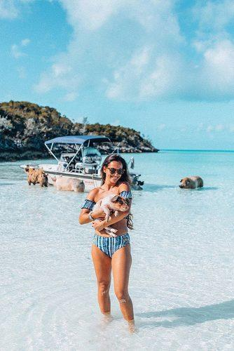 affordable honeymoon packages bahamas girl at the beach with cute pig