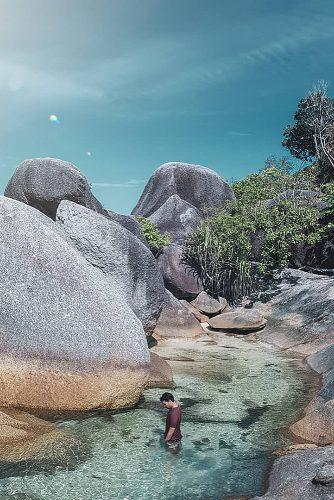affordable honeymoon packages belitung island man in the water