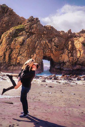 affordable honeymoon packages big sur california couple kissing at the beach