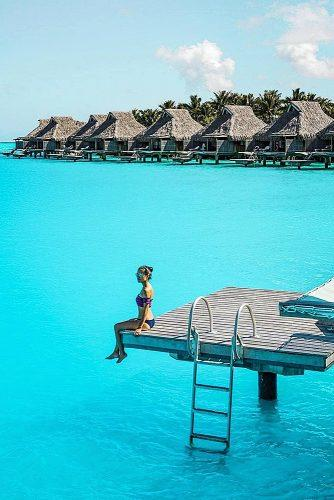 affordable honeymoon packages bora bora girl sitting near water