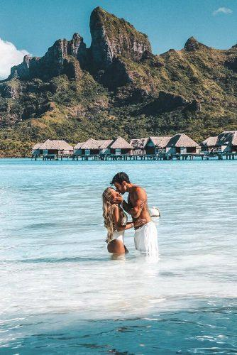 affordable honeymoon packages bora bora man and woman kissing at the water