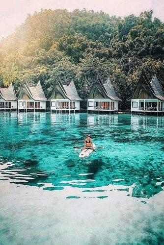affordable honeymoon packages el nido philippines girl at the serf near bungalo