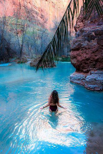 affordable honeymoon packages havasupai arizona girl relaxing in the lake