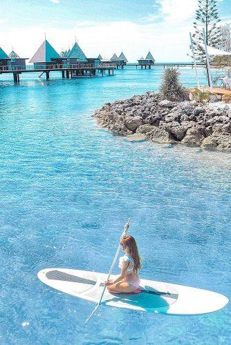 affordable honeymoon packages new caledonia girl on the serf board
