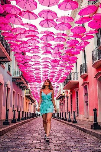 affordable honeymoon packages puerto rico girl on the street with colorful umbrellas