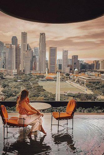 affordable honeymoon packages singapore girl in the cafe with city view