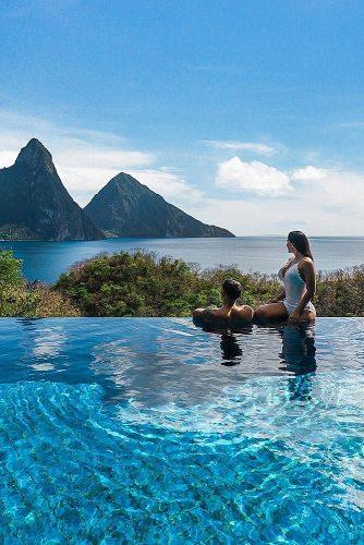 affordable honeymoon packages st lucia couple in the pool with beautiful view
