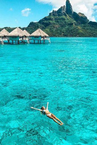 affordable honeymoon packages tahiti bungalos girl in the water
