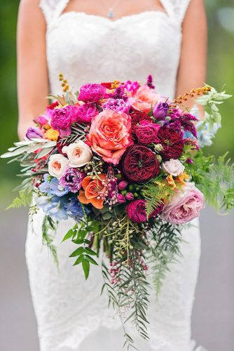beautiful wedding bouquets cascade with greens and bright flowers white pink claret blue calli b photography