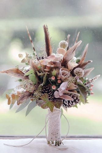 beautiful wedding bouquets with feathers cones leaves decorated with lace j e n o w e n s via instagram