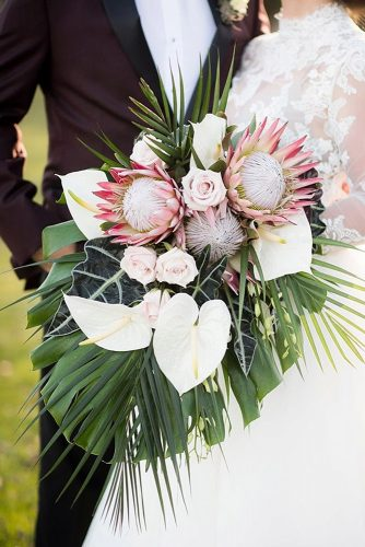 beautiful wedding bouquets with protein and large tropical leaves aislinn kate photography via instagram