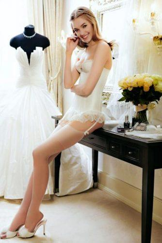 bridal corset white lingerie with stockings a bride in the room near a wedding dress agent provocateur via instagram