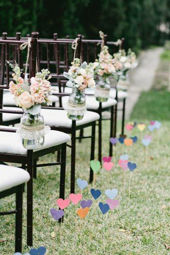 cheap wedding decorations colorful hearts made of paper at the wedding chairs decorated with mason jar with pink flowers one love photo