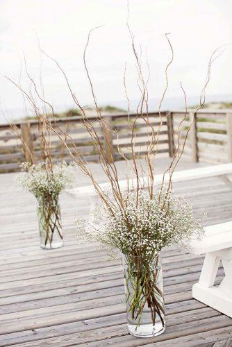 cheap wedding decorations flowers gypsophila in tall vases with wooden branches kristi midgette photography