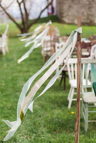 cheap wedding decorations wedding aisle decorated with white ribbons ashley bartoletti photography