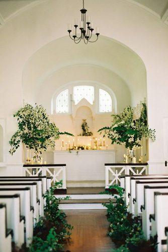 church wedding decorations aisle and altar decorated with greenery and candles sweet southern charm