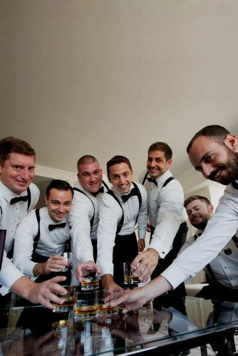 groomsmen photos ready with drink camelot photography studios