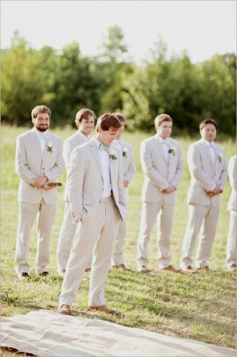 groomsmen photos they look to the bride glass jar photography