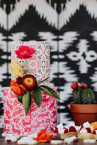 mexican wedding cake with bright patterns and fresh flowers by amy lynn photography via instagram