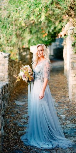straight heavily embroidered bodice with sleeves blue wedding dresses natalie wynn