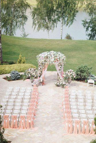 wedding ceremony decorations aisle and wedding altar with pink cloth and flowers sonya khegay