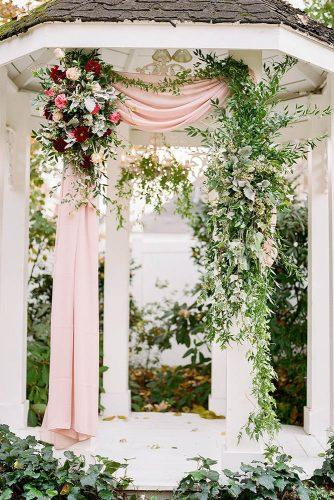 wedding ceremony decorations altar pink cloth and flowers jenna henderson photography
