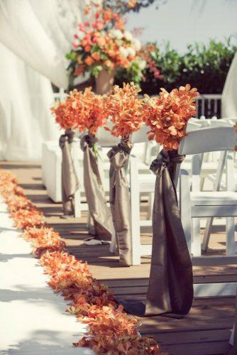wedding ceremony decorations autumn aisle with gold leaves and ribbons leanne pedersen photographers
