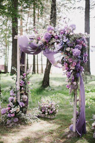 wedding ceremony decorations spring lilac flowers and cloth decorate altar art_petrov via instagram