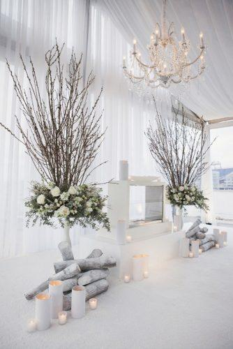 wedding ceremony decorations winter decor with branches white roses and candles sage nines event production