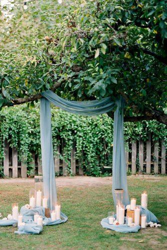 wedding ceremony decorations with blue draping cloth and candles dennis roy coronel