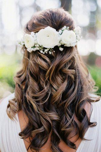 wedding hairstyles with flowers curly half up half down with roses jessicagoldphoto