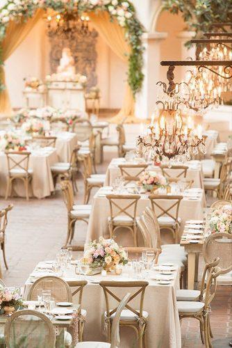 wedding reception decorations in elegant style in beige tones with beautiful chandeliers and flowers on tables studio emp photography