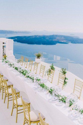 wedding reception decorations in white color decorated with greenery and sea view maria sila via instagram