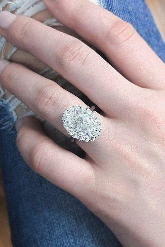 white gold engagement rings oval cut diamond floral halo