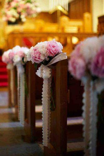 church wedding decorations aisle decorated with pink flowers and ribbons karlisch photography