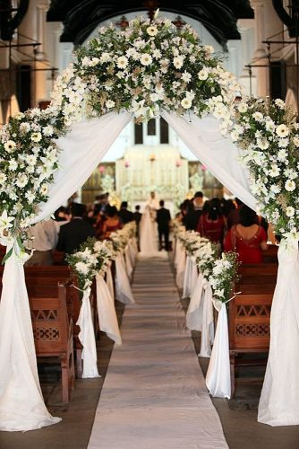 church wedding decorations at the beginning of the passage an arch of white fabric and flowers every bloomingthing