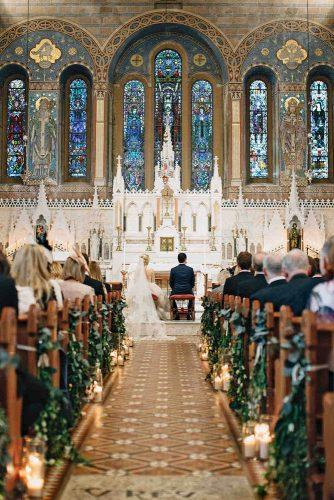 church wedding decorations ceremony with greenery and candles aisle paula ohara photography