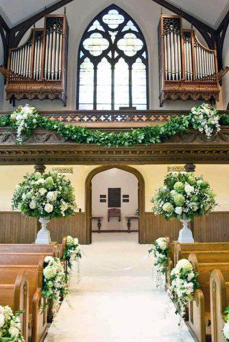 church wedding decorations hall decorated with greenery and white flowers aaron delesie photographer