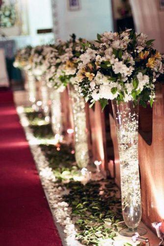 church wedding decorations tall glass vase with lights and flowers in aisle the kiwi studio