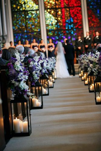 church wedding decorations the wedding pass is decorated with tall lanterns and lilac flowers serendipity photography
