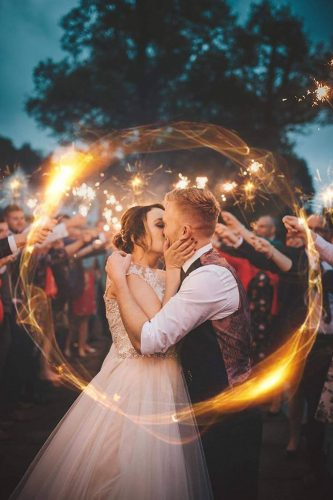 creative wedding kiss photos night lights bride and groom ladybirds photography