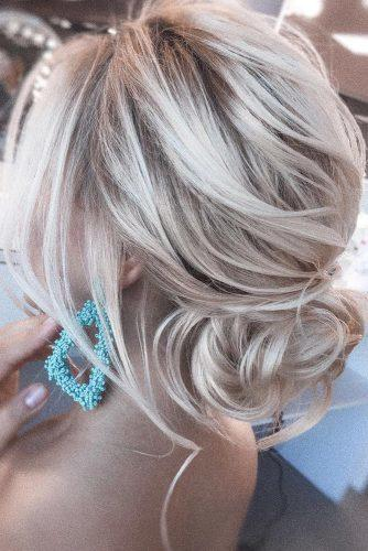 easy wedding hairstyles elegant airy bun with loose curls on blonde hair olesya_zemskova