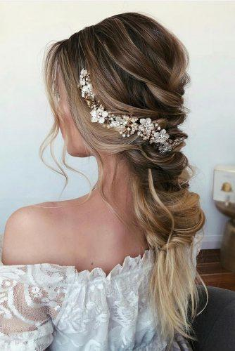 easy wedding hairstyles low long merry braid with accessorie caraclynebridal