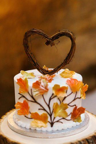 fall wedding cakes small white with gold leaves and brunches in form of heart on top la candella weddings