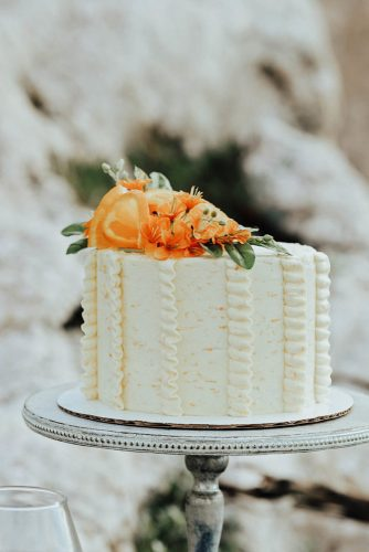 fall wedding cakes small white with ruffles flowers and citrus emily white via instagram
