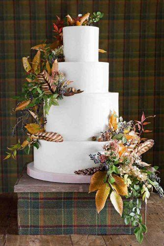 fall wedding cakes tall white with leaves and dry flowers jose villa