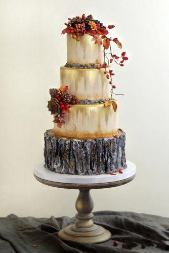 fall wedding cakes tall white with leaves and pine cones with zavrzlama